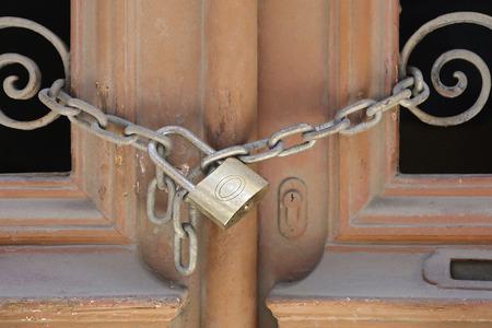 the lock: Locked padlock with hain at door