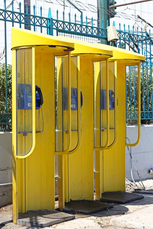 payphone: Three Yellow Payphone Cabins in Greece