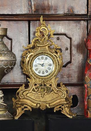 tabletop: Antique Tabletop Gold Clock at Flea Market