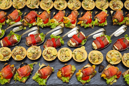 canapes: Decorative Garnished Modern Canapes Served at Party