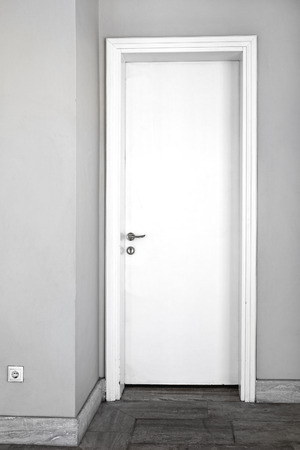 white door: Closed Plane White Door in Home Interior