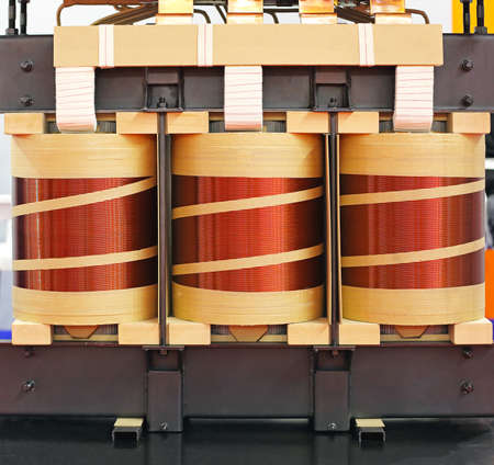 flux: Big Industrial Electric Transformer Device With Copper Wire Coils Stock Photo