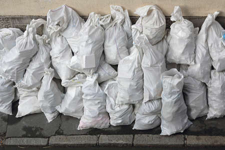 woven: Bunch of White Sacks With Rubble at Street Stock Photo