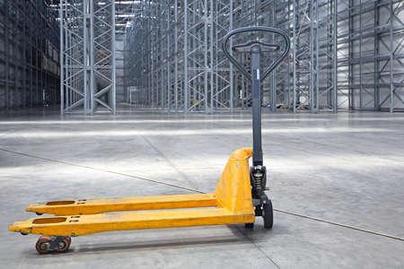 manuals: Manual Pallet Jack in Distributin Center Warehouse