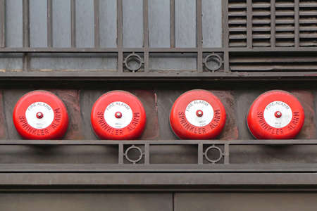 sprinkler alarm: Fire Sprinkler Alarm System at Building Exterior Stock Photo
