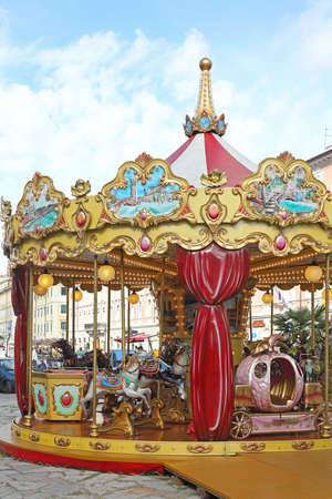 trieste: TRIESTE, ITALY - OCTOBER 14: Merry Go Round in Trieste on OCTOBER 14, 2014. Traditional Carousel with Horses Ride at Park in Trieste, Italy.