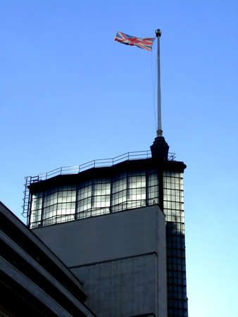 flaunt: English flag on a foremast on a top of the building Stock Photo