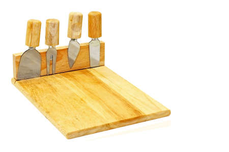 knifes: Wooden board and four cheese knifes isolated Stock Photo