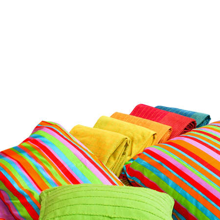 red pillows: Colorful bedding pillows and blankets with straps isolated Stock Photo
