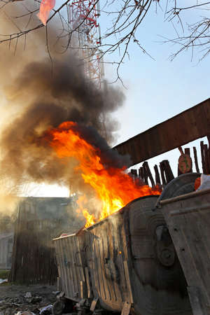 dumpster: Dumpster fire with heavy smoke pollution from garbage