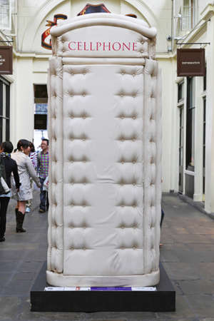 covent: LONDON, UNITED KINGDOM - JUNE 23  Telephone booth in London on JUNE 23, 2012  Padded Cell Phone Box from Bert Gilbert at Covent Garden in London,  United Kingdom  Editorial