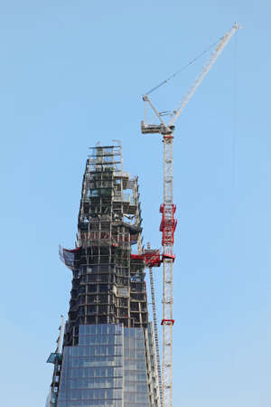 southwark: LONDON, UNITED KINGDOM - NOVEMBER 18  The Shard building in London on NOVEMBER 18, 2011  The Shard skyscraper with crane during constructon at Southwark in London, United Kingdom
