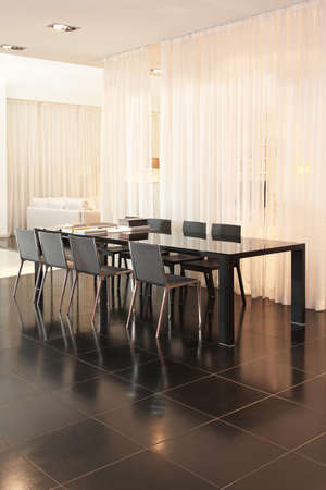 dining table and chairs: Table with eight chairs in dining room