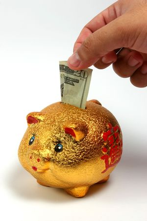 Golden piggy bank on a white background, isolated. photo