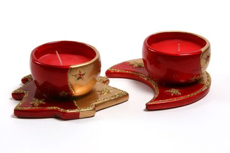 candleholders: Red christmas candles on various christmas theme candleholders.