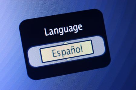 spoken: LCD display with the world Language and a selection of Spanish. Stock Photo