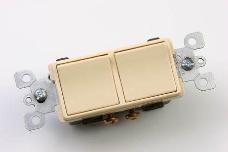Dual electrical switch, on a white background. photo