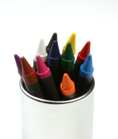 Multicolored crayons in a stainless steel can on a white background.