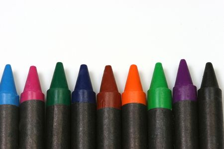 stimuli: Multicolored crayons wrapped in black on a white background.