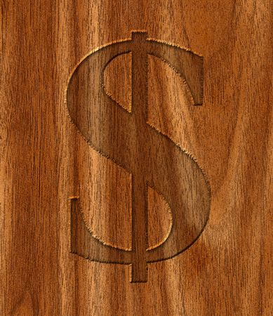 Rustic engraving of a dollar sign on wood. photo