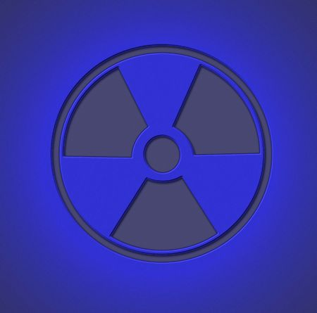 Radioactive sign engraved on metal sheet with blue light photo