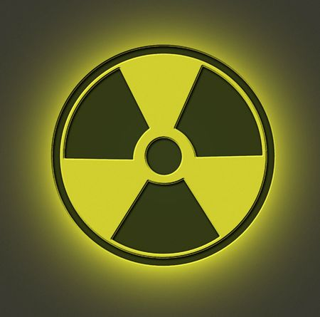 tridimensional: Radioactive sign engraved on metal sheet with yellow light