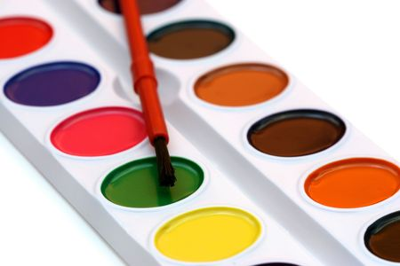 stimuli: Watercolors and brush isolated on a white background with shallow depht of field.