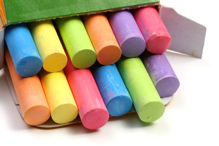 stimuli: Colored chalks on a box over white background Stock Photo