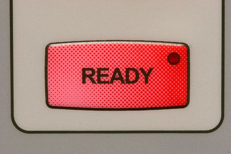 interrupt: Ready button on a medical laser unit. Stock Photo