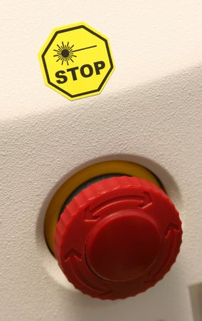 Emergency stop button on a medical laser unit. photo