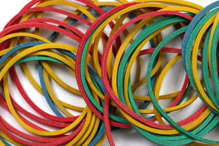 consumables: Colored rubber bands over a white background.