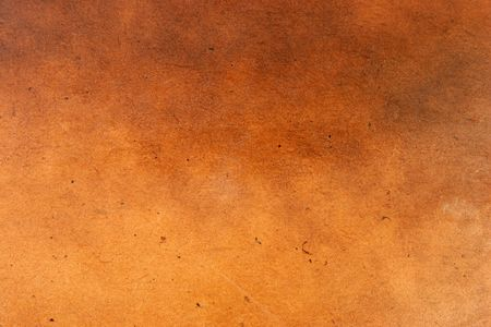 tonal: Wood with a leather finish used for background and texture.
