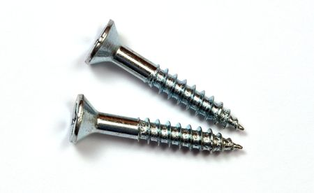 Iron screws over a white background. photo