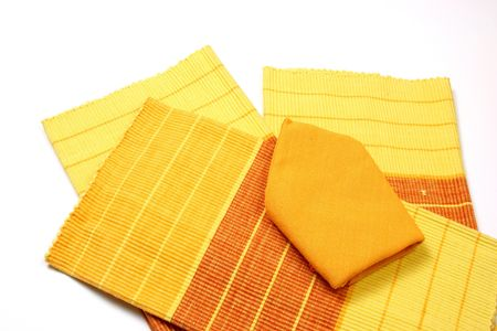 placemats: Decorative elements napkins and placemats of various colors. Stock Photo