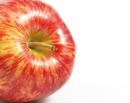 comestible: Lateral appearing red apple over a white background.