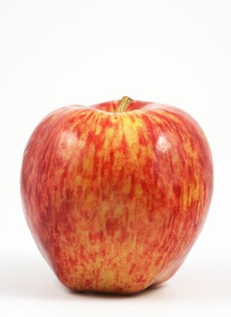 comestible: Vertical view of a red apple over a white background. Stock Photo