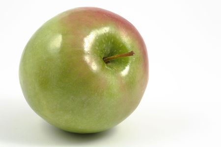 comestible: Green apple over a white background, horizontal format.