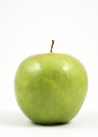 comestible: Vertical photo of a green apple over a white background. Stock Photo