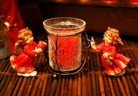 Angel figures-figurines with Christmas colors and a candle, decoration with warm light. Stock Photo - 609119