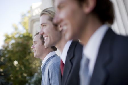 three business men standing and smiling in same direction Stock Photo - 2966967