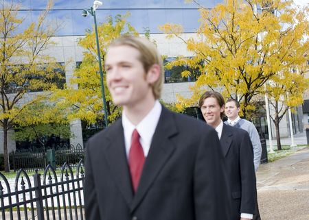 three business men standing and smiling in same direction Stock Photo - 2967073