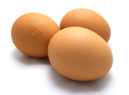 Three eggs on white background Stock Photo