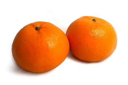Two mandarin oranges on white background. Lunar New Year items.