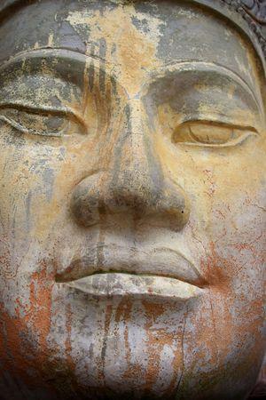 An ancient stlye big face sculpture.