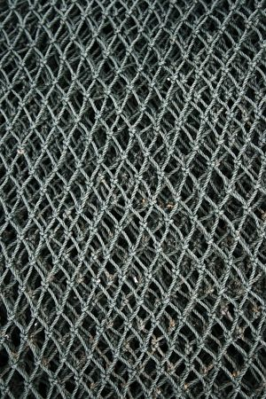 Close up of fishing net found in a fishing village.