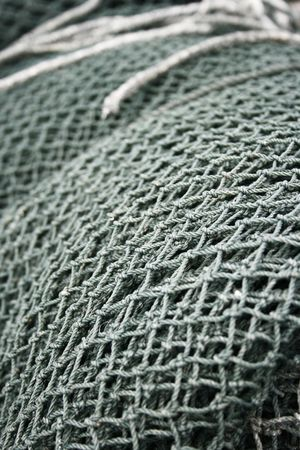 commercial fishing net: Close up of fishing net found in a fishing village.