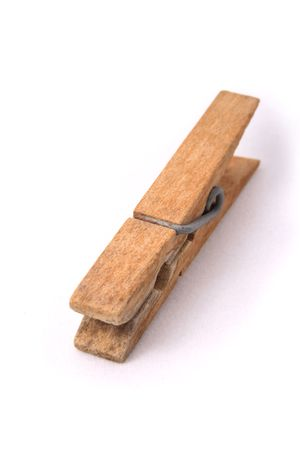clothepeg: Old wooden clip on white background.