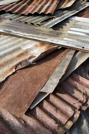 corrugated iron: A stack of old Zinc which use for roofing.