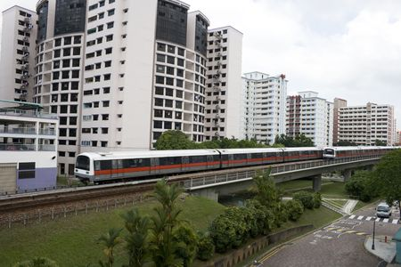 Singapore residential area with train in front.