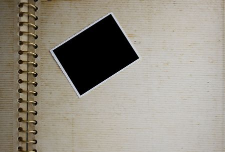 photo album page: Background made from an open old grunge album with photo on it. Stock Photo